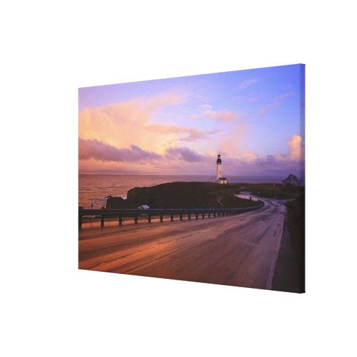 A Road & A Lighthouse Along The Coast At Sunset Canvas Print