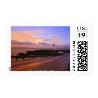 A Road & A Lighthouse Along The Coast At Sunset Stamp