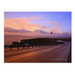 A Road & A Lighthouse Along The Coast At Sunset Postcard