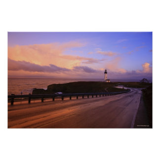 A Road & A Lighthouse Along The Coast At Sunset Poster