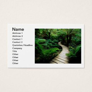 A road in the middle of the wild forest business card