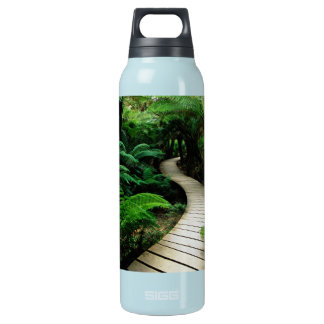 A road in the middle of the wild forest insulated water bottle