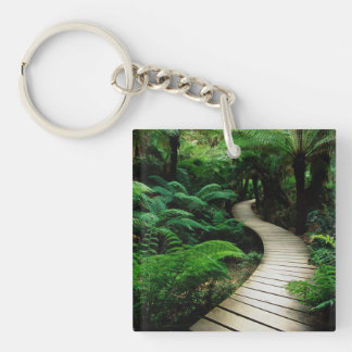 A road in the middle of the wild forest keychain