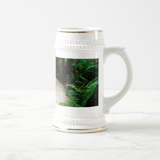 A road in the middle of the wild forest 18 oz beer stein