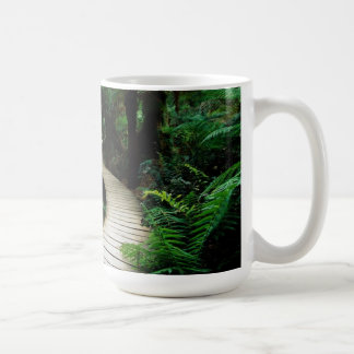 A road in the middle of the wild forest mug