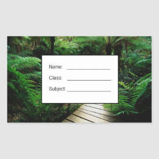 A road in the middle of the wild forest rectangular sticker