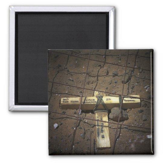 A road repair crew places a cross magnet