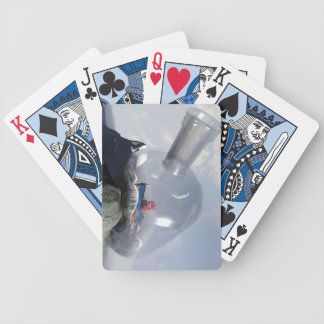 A Robot in a Bottle Bicycle Playing Cards