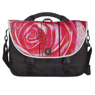 A rose image on a grungy wood panel laptop messenger bag