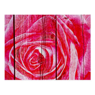 A rose image on a grungy wood panel postcard