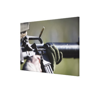 A round flies from the chamber of an M-16A2 Gallery Wrapped Canvas