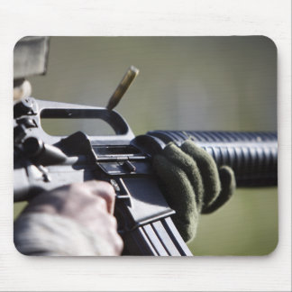 A round flies from the chamber of an M-16A2 Mouse Pad