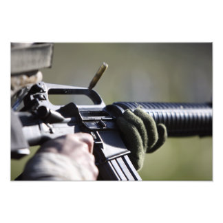 A round flies from the chamber of an M-16A2 Photo