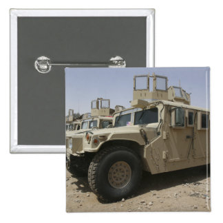 A row of humvees from Task Force Military Polic Button