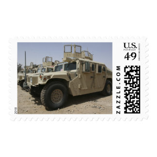 A row of humvees from Task Force Military Polic Postage
