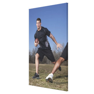 A running play during a touch football game. canvas print