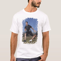 A running play during a touch football game. T-Shirt