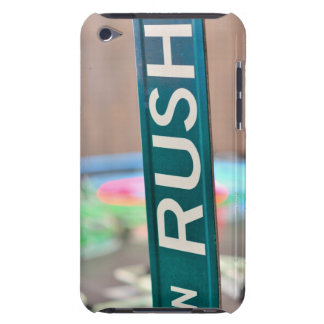 A Rush Street street sign in front of a neon Barely There iPod Case