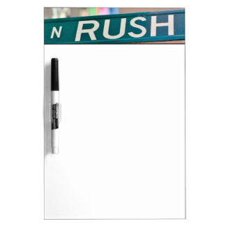 A Rush Street street sign in front of a neon Dry Erase Board