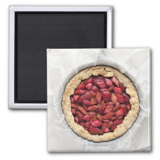 A rustic, homemade tart filled with fresh 2 inch square magnet