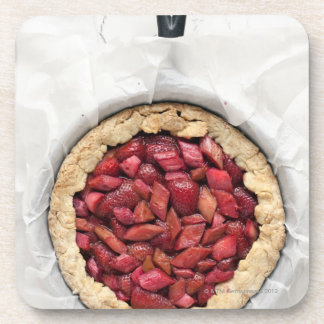 A rustic, homemade tart filled with fresh beverage coaster