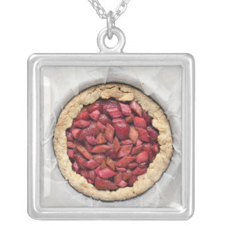 A rustic, homemade tart filled with fresh silver plated necklace