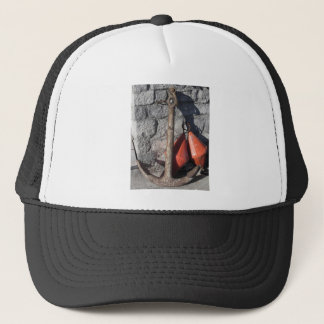 A rusty anchor and two orange conical buoy trucker hat