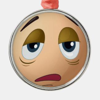 A sad egg round metal christmas ornament