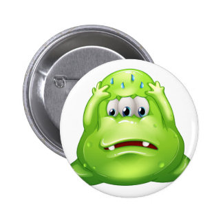 A sad greenslime monster 2 inch round button
