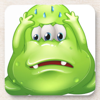 A sad greenslime monster coaster