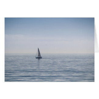 A sailboat on a calm sea stationery note card