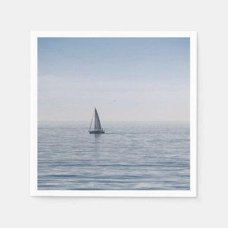 A sailboat on a calm sea napkin