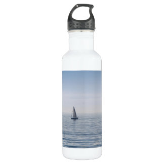 A sailboat on a calm sea water bottle