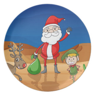 a santa claus and a reindeer dinner plate