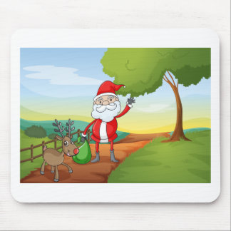 a santa claus and a reindeer mouse pad