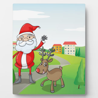 a santa claus and a reindeer plaque