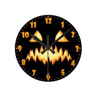 A Scary Jack O Lantern In The Dark Round Clock