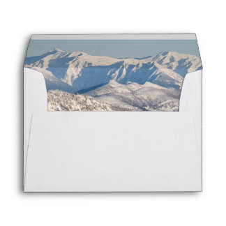 A Scenic View of Snowy Mountains and Trees. Envelope