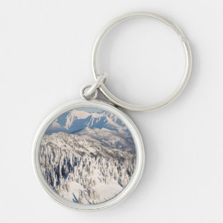 A Scenic View of Snowy Mountains and Trees. Keychain