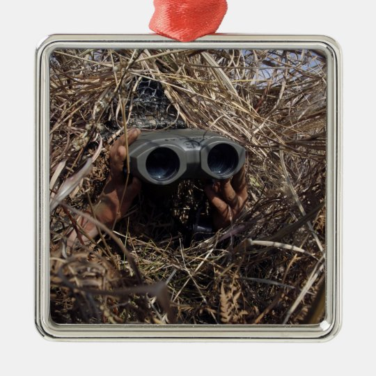 A scout observer practices observation techniqu metal ornament