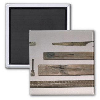 A scribe's instruments (wood, ivory, bronze and en 2 inch square magnet