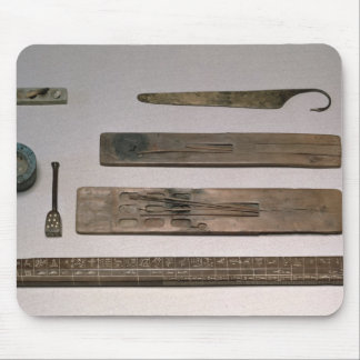 A scribe's instruments (wood, ivory, bronze and en mouse pad