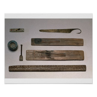 A scribe's instruments (wood, ivory, bronze and en poster