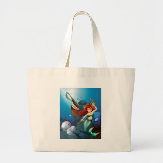 A sea with a mermaid near the wrecked boat jumbo tote bag