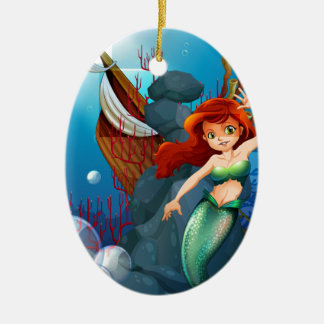 A sea with a mermaid near the wrecked boat Double-Sided oval ceramic christmas ornament
