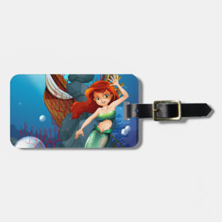 A sea with a mermaid near the wrecked boat travel bag tag