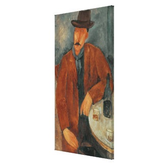 A seated man leaning on a table canvas print
