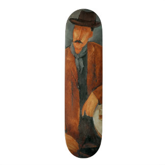 A seated man leaning on a table skateboard deck