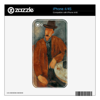 A seated man leaning on a table iPhone 4S skin
