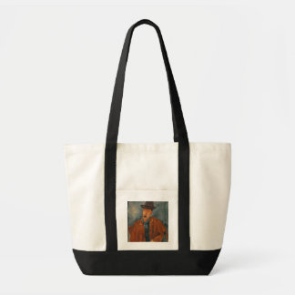 A seated man leaning on a table tote bag